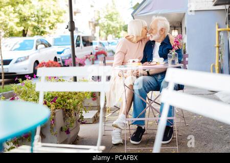 Pleasant senior couple having lunch - Stock Photo