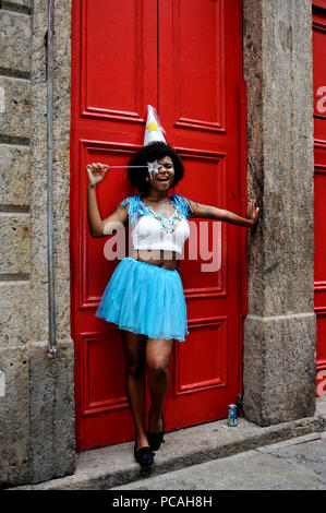 Brazil - February 26, 2017: Reveler dressed up as a fairy godmother smiles for the camera at a carnival street party in Rio de Janeiro - Stock Photo