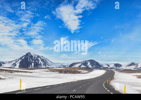 The Iceland Ring Road in North Iceland, passing through dramatic mountain scenery. - Stock Photo