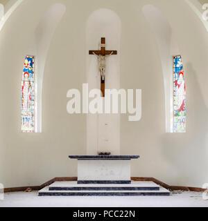 Church interior colourful Italy bright light cute crucifix alter stain glass windows dome - Stock Photo