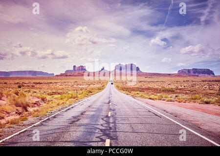 Scenic road to Monument Valley, color toned picture, USA. - Stock Photo