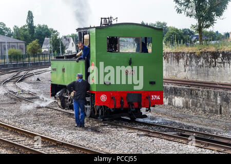 Steam Train and Workers at Noyelles Sur-Mer Station, Chemin de Fer De la Baie De Somme, Picardy, France - Stock Photo