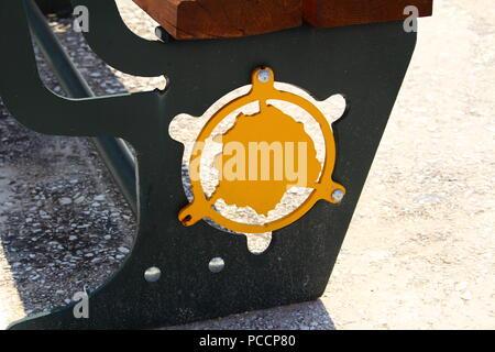 A closeup photo of a bench on the street in Leminas Thassos, Greece - Stock Photo