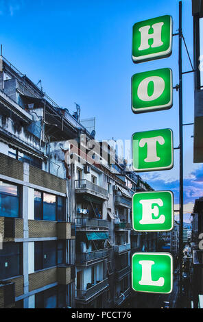 Hotel signboard in a street of downtown Athens at nightfall. Attica, Greece. - Stock Photo