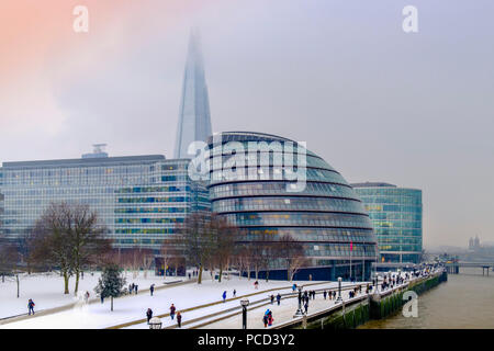 The South Bank of the River Thames showing the Shard and City Hall, HQ of the Mayor of London, in snow, London, England, United Kingdom, Europe - Stock Photo
