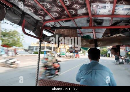 Tuk tuk driver in the streets of Kampt Town, Cambodia, Indochina, Southeast Asia, Asia - Stock Photo