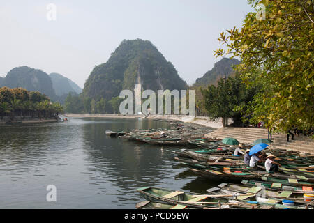 Row boats in Tam Coc used to take tourists around the Trang An Landscape Complex in Ninh Binh Province, Vietnam, Indochina, Southeast Asia, Asia - Stock Photo