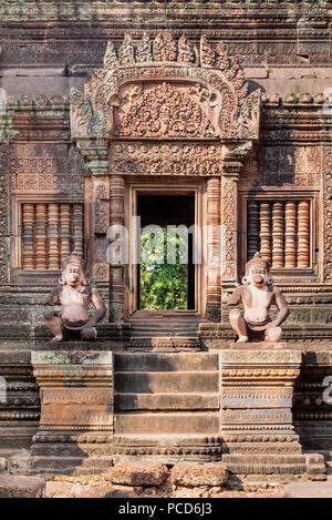 Detailed carving on the facade of a temple at Banteay Srei in Angkor, UNESCO World Heritage Site, Siem Reap, Cambodia, Indochina, Southeast Asia, Asia - Stock Photo