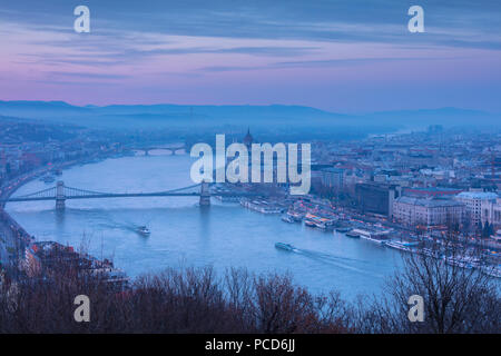 View over the city and River Danube at dusk from The Citadel on Gellert Hill, Budapest, Hungary, Europe - Stock Photo