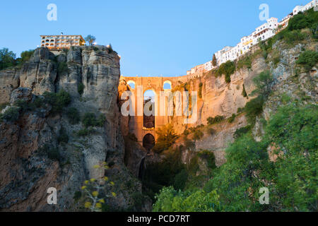 Puente Nuevo (New Bridge) floodlit at night and the white town perched on cliffs, Ronda, Andalucia, Spain, Europe - Stock Photo
