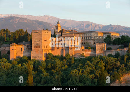 The Alhambra, UNESCO World Heritage Site, and Sierra Nevada mountains in evening light from Mirador de San Nicolas, Granada, Andalucia, Spain, Europe - Stock Photo