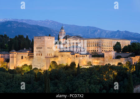 The Alhambra, UNESCO World Heritage Site, and Sierra Nevada mountains from Mirador de San Nicolas, Granada, Andalucia, Spain, Europe - Stock Photo