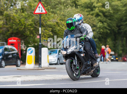 Person with pillion passenger riding on a Kawasaki Z1000SX motorbike in West Sussex, England, UK. - Stock Photo