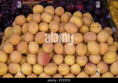 Juicy fresh apricots on window counter, on natural light. - Stock Photo