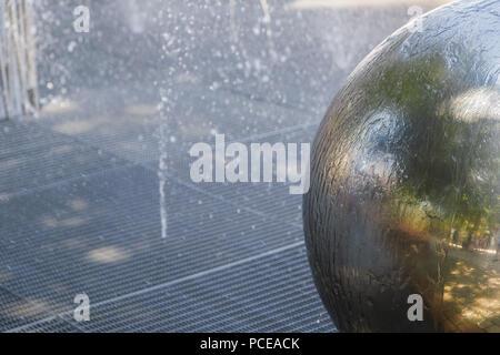 Chrome ball in the fountain, new design. - Stock Photo