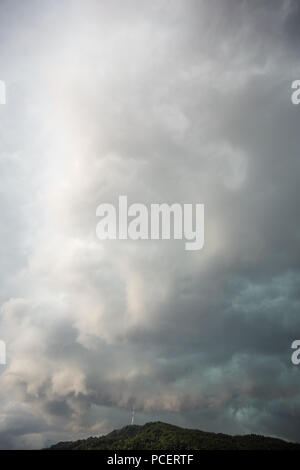 stormy cloud over uetliberg mountain in zurich switzerland with tv tower grey sky - Stock Photo