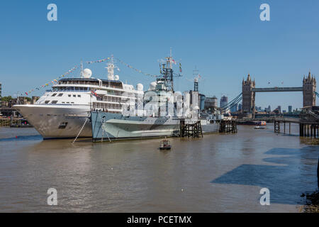 the silversea cruise ship or liner silver wind next to HMS Befast in central london. - Stock Photo