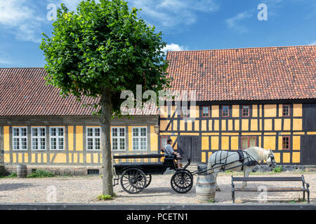 A carriage in front of some old houses, The Old Town in Aarhus, Denmark - Stock Photo