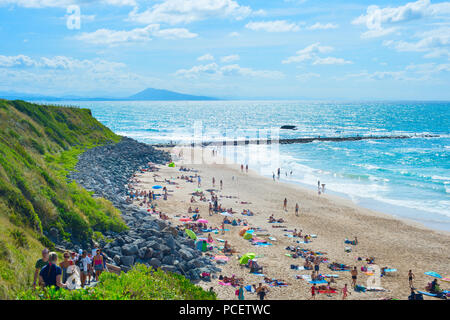 BIARRITZ, FRANCE - AUGUST 11, 2017: People at the Milady beach in a hot summer day. Biarritz famous summer vacation tourists destination. - Stock Photo