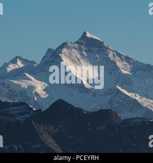 Mount Jungfrau just after sunset, famous mountain in the Bernese Oberland. View from Mount Brienzer Rothorn. - Stock Photo