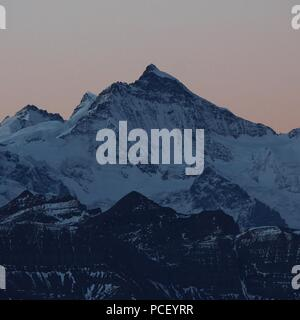 Famous mountain Mount Jungfraujoch seen from Mount Brienzer Rothorn. - Stock Photo