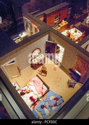 A 1937 bedroom murder scene is re-created in miniature by criminologist and model maker Frances Glessner Lee using dolls, doll furniture, a doll house room and red paint depicting blood. - Stock Photo