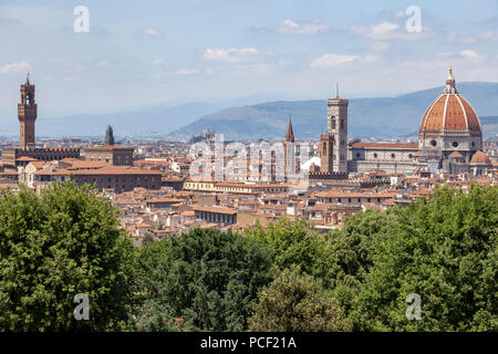 A view of Florence taken from the vantage point of  the MichelAngelo square and focusing from left to right on: the Palazzo Vecchio and the Duomo. - Stock Photo