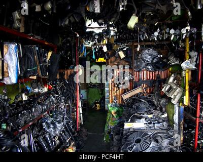 ANTIPOLO CITY, PHILIPPINES - JULY 30, 2018: Assorted used car spare parts sold at a surplus shop. - Stock Photo