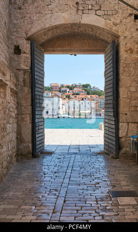 Entrance gate to old town of Trogir a historic town and harbor on the Adriatic coast in Split-Dalmatia County, Croatia - Stock Photo