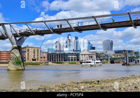 River Thames at low tide. London, England, UK. South Bank beach below the Millennium Bridge - Stock Photo