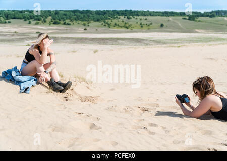 Photographing the model in the sands - Stock Photo