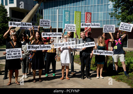 London, UK. 2nd August 2018. Protest at the Design Museum, London by artists who have withdrawn their work from the Hope to Nope, Graphics and politics 2008-18 exhibition after the museum allowed a major arms company,Leonardo, to hold a private event alongside their artwork. The group gather outside the museum holding placards saying 'Nope to arms' and 'The revolution will not be televised'. Credit: Jenny Matthews/Alamy Live News - Stock Photo