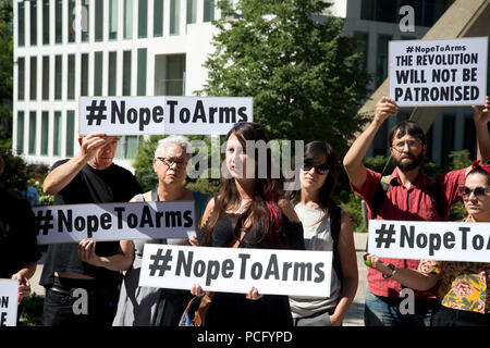 London, UK. 2nd August 2018. Protest at the Design Museum, London by artists who have withdrawn their work from the Hope to Nope, Graphics and politics 2008-18 exhibition after the museum allowed a major arms company to hold a private event alongside their artwork. The group gather outside the museum holding placards saying 'Nope to arms' and 'The revolution will not be televised'. Credit: Jenny Matthews/Alamy Live News - Stock Photo