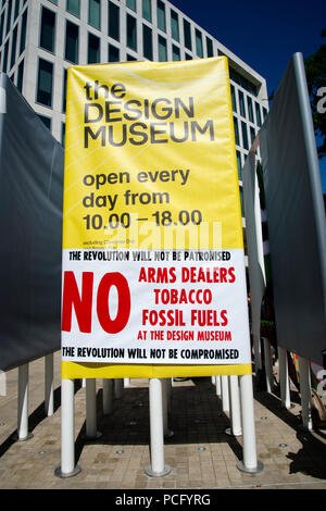 London, UK. 2nd August 2018. Protest at the Design Museum, London by artists who have withdrawn their work from the Hope to Nope, Graphics and politics 2008-18 exhibition after the museum allowed a major arms company to hold a private event alongside their artwork. A Brandalism poster wrapped the around offical musem information. Credit: Jenny Matthews/Alamy Live News - Stock Photo