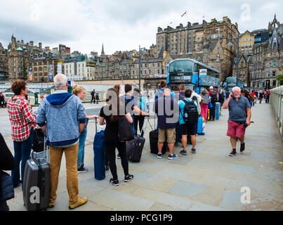 Edinburgh, Scotland, UK. 2nd August, 2018. At the start of the Edinburgh Festival many tourists are arriving in the city , however, many people are also leaving the city and heading to the airport, as this long queue for the airport Express 100 bus shows. Credit: Iain Masterton/Alamy Live News - Stock Photo