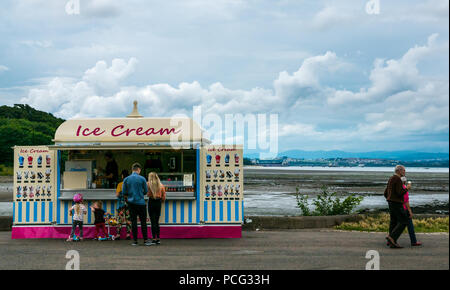 Cramond, Edinburgh, Scotland, United Kingdom, 2nd August 2018. People buying ice creams from Fotheringham's ice cream stall on a sunny Summer day at the coast in the village - Stock Photo