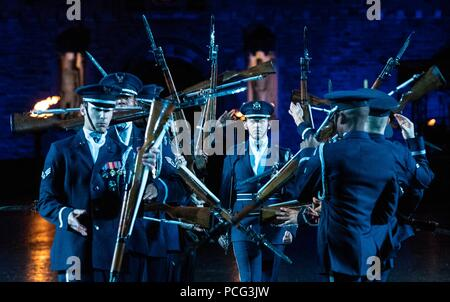 Edinburgh, UK. 2nd Aug 2018. The cast of the spectacular Royal Edinburgh Military Tattoo perform together in full dress on the Edinburgh Castle Esplanade. The Tattoo takes place from 3 August 2018 to 25 August 2018. Credit: Rich Dyson/Alamy Live News - Stock Photo