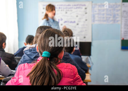 school children are participating actively in class. Education. - Stock Photo