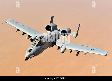 An A-10 Thunderbolt II, assigned to the 74th Fighter Squadron, Moody Air Force Base, GA, returns to mission after receiving fuel from a KC-135 Stratotanker, 340th Expeditionary Air Refueling Squadron, over the skies of Afghanistan in support of Operation Enduring Freedom, May 8, 2011. - Stock Photo