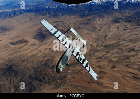 An A-10 Thunderbolt II from the 23rd Fighter Group, Moody Air Force Base, Ga., peels away after being refueled from a KC-135 Stratotanker, assigned to the 340th Expeditionary Air Refueling Squadron, while flying over Afghanistan in support of Operation Enduring Freedom, Feb. 26, 2011. - Stock Photo