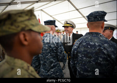 DUBLIN (Aug. 31, 2012) Chief of Naval Operations (CNO) Adm. Jonathan Greenert congratulates newly reenlisted Sailors and warfare pin recipients aboard the amphibious dock-landing ship USS Fort McHenry (LSD 43) before an all hands call with Secretary of the Navy (SECNAV) the Honorable Ray Mabus, CNO and Master Chief Petty Officer of the Navy Rick West. SECNAV, CNO, MCPON and the Sailors and Marines aboard Fort McHenry are in Dublin to support the Emerald Isle Classic NCAA football game between Navy and Notre Dame. - Stock Photo