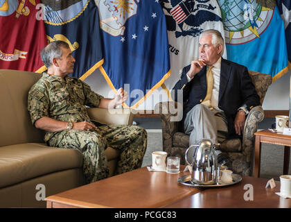 CAMP H.M. SMITH, Hawaii (August 4, 2017)— Adm. Harry Harris, Commander of U.S. Pacific Command (PACOM), has a conversation with U.S. Secretary of State Rex Tillerson at PACOM Headquarters. Secretary Tillerson is traveling to Manila, Bangkok, and Kuala Lumpur to meet with his counterparts and discuss a range of issues including the denuclearization of the Korean Peninsula, maritime security, and counterterrorism.  Secretary Tillerson's travel reaffirms the Administration's commitment to further broaden and enhance U.S. economic and security interests in the Indo-Asia-Pacific region. - Stock Photo