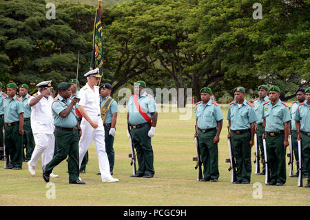 PORT MORESBY, Papua New Guinea (April 15, 2014)  Adm. Samuel J. Locklear, III, commander of U.S. Pacific Command, conducts an open ranks inspection at Murray Barracks as part of welcome parade. Locklear is in Papua New Guinea to meet with the country's political and military leaders to reaffirm the U.S-Papua New Guinea bilateral relationship and the strength of the partnership. - Stock Photo