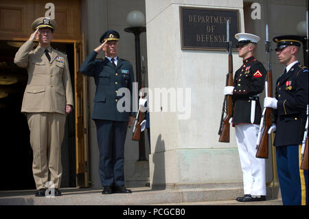 Chairman of the Joint Chiefs of Staff Adm. Mike Mullen, U.S. Navy, welcomes Supreme Commander of the Swedish Armed Forces Gen. Sverker Goranson to the Pentagon on Aug. 5, 2010. - Stock Photo