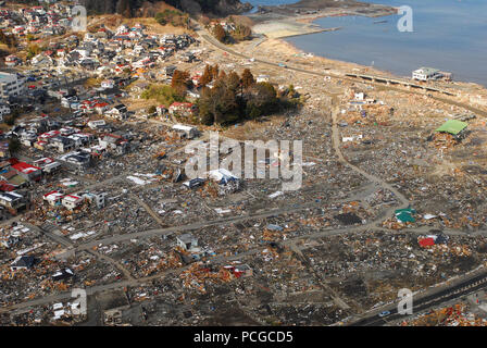 Japan (March 18, 2011) An aerial view of damage to Sukuiso, Japan, a week after a 9.0 magnitude earthquake and subsequent tsunami devastated the area. - Stock Photo