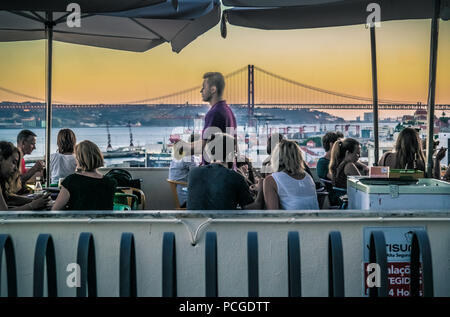 Lisbon. Open air restaurant Noobai on viewpoint Miradouro de Santa Catarina. - Stock Photo
