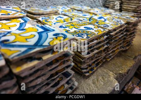 Lisbon. Antique tiles (azuleijos) in a shop in Principe Real - Stock Photo