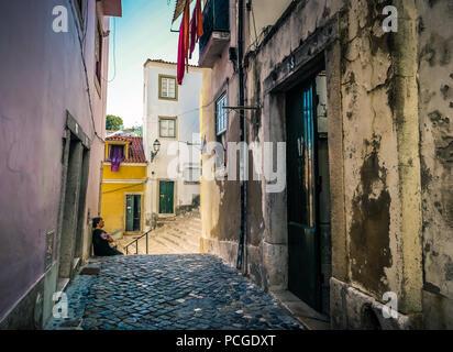 Lisbon. Narrow alley in the arabic rooted Alfama neighborhood. - Stock Photo