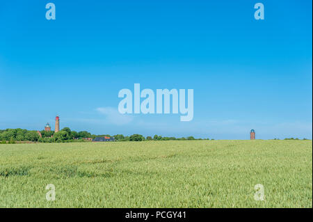 Landscape with cornfield at Cape Arkona with the lighthouses and former Marinepeilturm tower in the background, Putgarten, Rügen, Mecklenburg-Vorpomme - Stock Photo