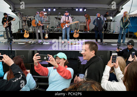 YOKOSUKA, Japan (October 30, 2016) – A person in the crowd takes a selfie with recording Artist Jimmy Buffett and the Coral Reefer Band during a Navy Entertainment Sponsored concert for Sailors and family members at Fleet Activities (FLEACT) Yokosuka.  FLEACT Yokosuka provides, maintains, and operates base facilities and services in support of 7th Fleet's forward-deployed naval forces, 83 tenant commands, and 24,000 military and civilian personnel. - Stock Photo